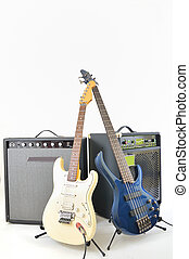 guitars and amplifiers on white background