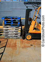 Forklifter - Yellow loaded forklifter truck in the...