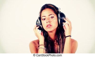 close-up of beautiful young woman listening to music on...