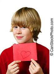 Be Mine - Young boy holds up an envelope with a heart drawn...