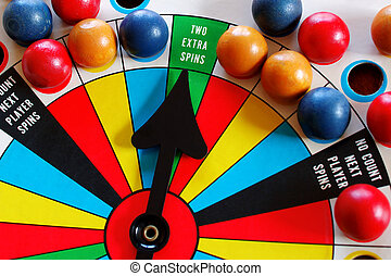 Game of Chance - An antique spinner game with the arrow...