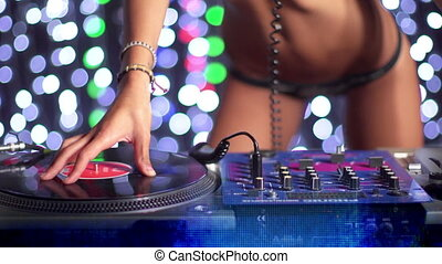 sexy female dj dancing and playing records