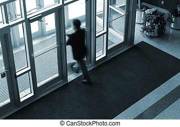 Into the Light - Motion blur of businessman exiting an...