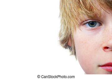 watching - Closeup of half of a boys face isolated on a...