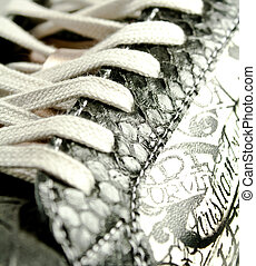 Shoe laces on a pair of sneakers