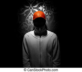Red hat stands out of a black and white photo of a faceless...