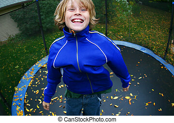 Jumping High - Closeup of a teenaged boy on a trampoline