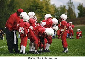 Calling the play - A young quarterback gives his team the...