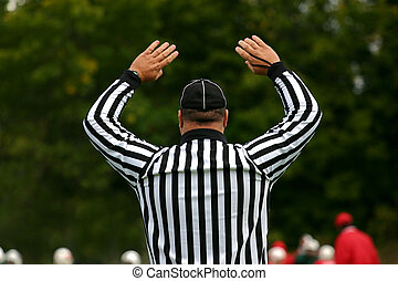 Penalty - The football referee signals that the touchdown...