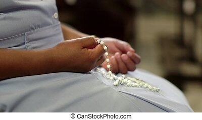 Catholic sister praying in church - People and religion,...