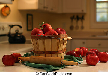 baking day - Bushel basket of apples on a kitchen counter