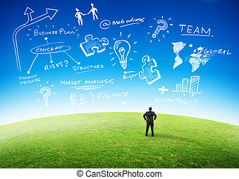 Business Planning Concept, Businessman looking at plans in...