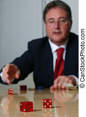 business is a gamble series 2 - Businessman throwing red...
