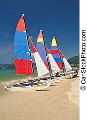 sail boat on patong beach, phuket, thailand