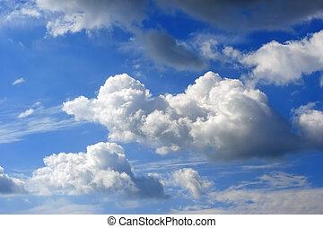 Cloudscape - A bright blue sky with puffy cumulus clouds