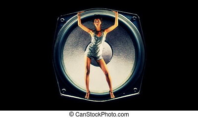 sexy gogo dancer inside a hifi speaker, is forced around by...
