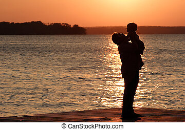 The Good Things in Life - A father holds up his young sun...