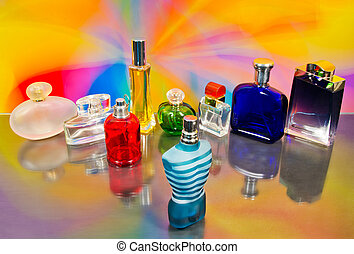 set of luxury perfume bottles on colorful background