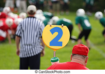 Second Down - Second down marker is in the foreground while...