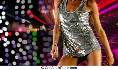 a sexy woman dances in a sparkly disco dress, shot as a sequence of images at 6 frames per second, with disco lights background