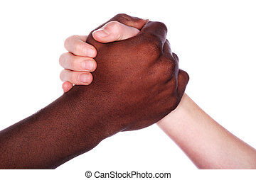 Brotherhood - Two hands of different races grip each other...