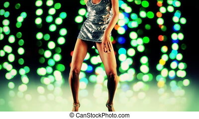 a sexy woman dances in a sparkly disco dress, shot as a...