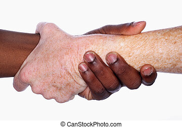 Connection - Two hands of different races grip each other in...
