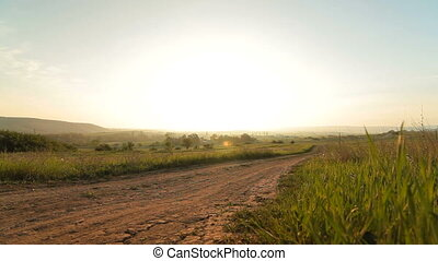 Morning rural landscape at sunrise, wide-angle lens, surface...