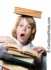 Balancing Act - A surprised boy holds a book open while...