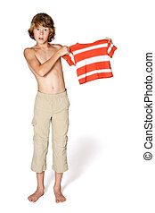 Growing Pains - A teenager holds up a shirt that he has...