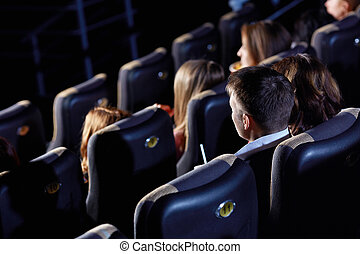 Cinema hall - Group of people watching movie at the cinema