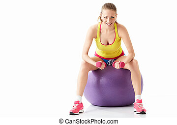 Fitness - Young girl with fitball on white background