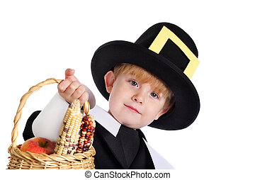 Pilgrim bearing gifts - A young boy in a pilgrim costume...