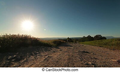 Cross-Country Biking At Sunrise - Cyclist riding bicycle...
