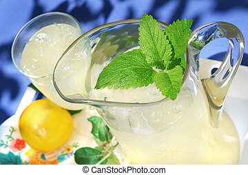 Pitcher of Lemonade with a sprig of mint