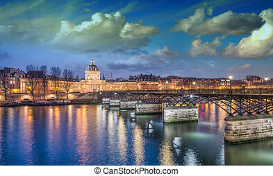 Beautiful sunset colors of Paris and Seine river.