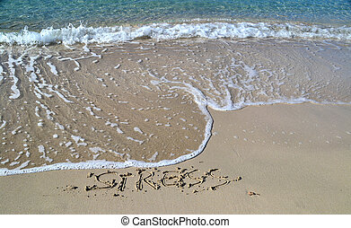 The word Stress written in the sand, the beach is a good way...