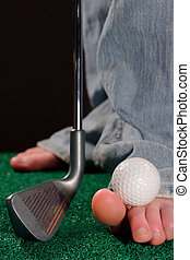Improvise - A golfer holds the ball on their toe as they are...