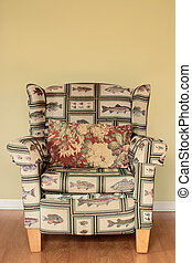 Arm Chair - A tacky Arm Chair with a fish pattern well worn...