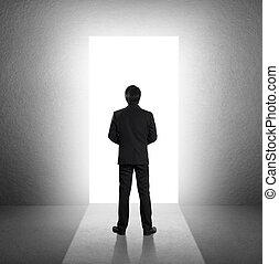 Man walking towards open door - businessman walking towards...
