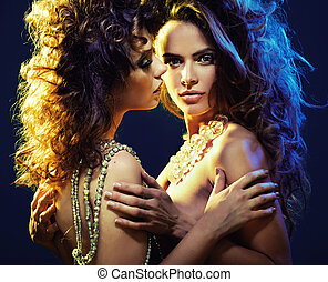 Two curly-haired ladies in sexy hug - Two curly-haired girls...