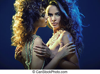Nude women wearing only jewelery