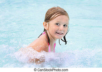 Happy girl in a pool