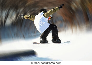 Snowboarder Jumping off the rail - a snowboarder gets air...