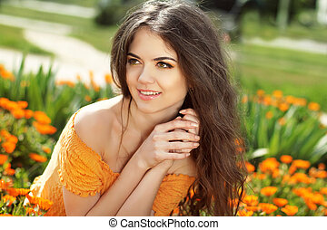 Enjoyment. Happy smiling brunette woman with arms near face...