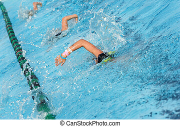 Swim Team Practice - Several swimmers in a swim lane...