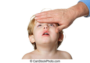 Sick Child - an father is touching the forehead of a sick...