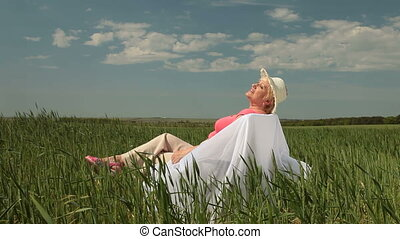 Senior woman on the nature - Senior woman enjoying summer...