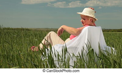 Senior lady relaxing outdoors - Senior lady enjoying summer...