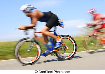 Racing bicycle, motion blur - Bicyclist race through the...